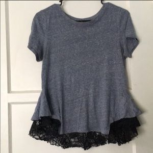 Free people top. The color is blue grey.
